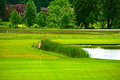 Golf course with lawn and lake in a swedish landscape Royalty Free Stock Photos