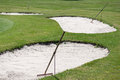Golf course sand bunker rake three Stock Images