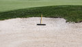 Golf course sand trap golfing with white and rake Stock Image
