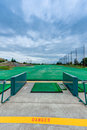 Golf driving range stations above ground top level of a two level Royalty Free Stock Image
