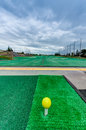 Golf driving range stations above ground top level of a two level Stock Photo