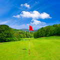 Golf field and blue sky. european landscape Royalty Free Stock Photo