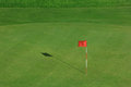 Golf field with red flag Royalty Free Stock Photo