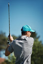 Golf follow through finishing pose of golfer swing iron club Stock Photos