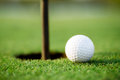Golf hole ball and close up Royalty Free Stock Photo