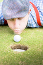 Golf Player Blowing The Ball Royalty Free Stock Images