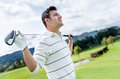 Golf player at the course male holding a club Royalty Free Stock Photo