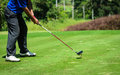 Golf player with putter Royalty Free Stock Photo