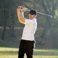 Golf player shots Royalty Free Stock Photo