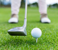 Golf player at the tee box hitting ball Stock Photo