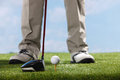 Golf player teeing up to hit ball a shot of Royalty Free Stock Photography