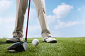 Golf player teeing up to hit ball a shot of Royalty Free Stock Photo