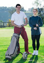 Golf players at golf course Royalty Free Stock Photo