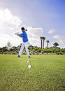 Golf practice golfer man with a row of balls on tees ready to hit driving range Royalty Free Stock Image