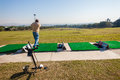 Golf practice range player mature male hitting some balls at the with at mount edgecombe courses one and two outside durban south Royalty Free Stock Photos