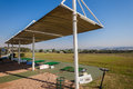 Golf practice range sun protection with shade awnings at mount edgecombe courses one and two in durban south africa Stock Image