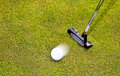 Golf putter club with golf ball white Royalty Free Stock Photography