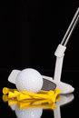 Golf putter and golf equipments different on the black glass desk Stock Photo
