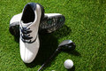 Golf shoes club and ball a shot of Royalty Free Stock Photography