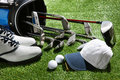 Golf shoes hat balls tee and clubs in bag a shot of Royalty Free Stock Photo