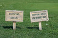 Golf signs chipping green and gcb members only on terrain Royalty Free Stock Image