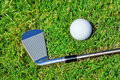 Golf stick ball closeup on the grass Royalty Free Stock Images