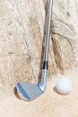 Golf stick and ball on the sand close up Royalty Free Stock Photos