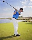 Golf swing man during on the fairway at a tropical resort Royalty Free Stock Photos