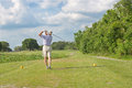 Golf swing a senior golfer displaying the proper posture of a Stock Photography