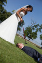 Golf and wedding bride groom playing Stock Image
