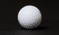Golfball white golf ball on dark background Stock Image