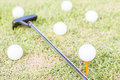 Golfclub and golfball on grass background Stock Images