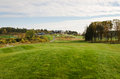 Golfcourse and clubhouse empty at autumn the on the hill Stock Images