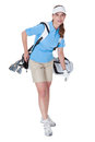 Golfer with a bag of clubs attractive female in golf clothing selecting an iron Stock Photography