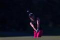 Girl Pro Golf Chip Ball Flight Royalty Free Stock Photo