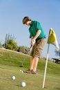 Golfer Concentrating On Making Putt Royalty Free Stock Photo