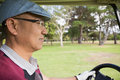 Golfer driving golf buggy Royalty Free Stock Photo
