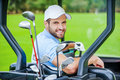 Golfer in golf cart. Royalty Free Stock Photo
