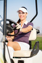 Golfer in golf cart smiling female driving Stock Images