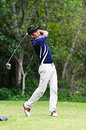 Golfer hitting a driver from the tee-box Royalty Free Stock Photo