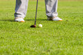 Golfer is hitting golf a on green grass Royalty Free Stock Images