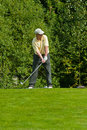 Golfer from Jupan finishes his swing Royalty Free Stock Photos