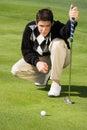 Golfer Lining Up Putt Royalty Free Stock Photo