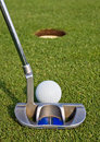 Golfer lining up a short putt Royalty Free Stock Photo