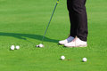 Golfer putting a golf ball in to hole Royalty Free Stock Photo