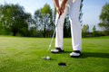Golfer putting Royalty Free Stock Photo