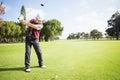 Golfer raising his golf club Royalty Free Stock Photo