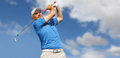 Golfer shooting a golf ball and blue sky Royalty Free Stock Photography