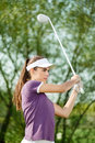 Golfer shooting a golf ball female Stock Photo