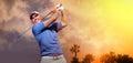 Golfer shooting a golf ball photo of Stock Photos